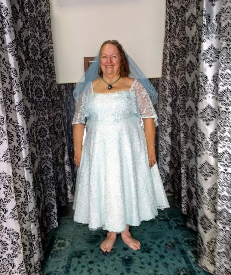 This custom tea length lace was dyed aqua. Check out the blue veil!